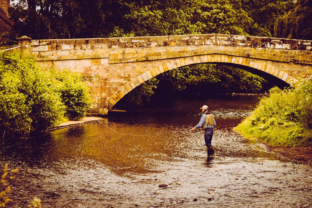 man fly fishing in the river seven | A New Lens Brings New Love For Photography | The Yorkshire Dad of 4