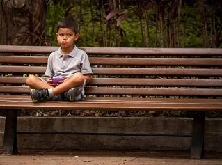 Boy on bench in Venezuela.