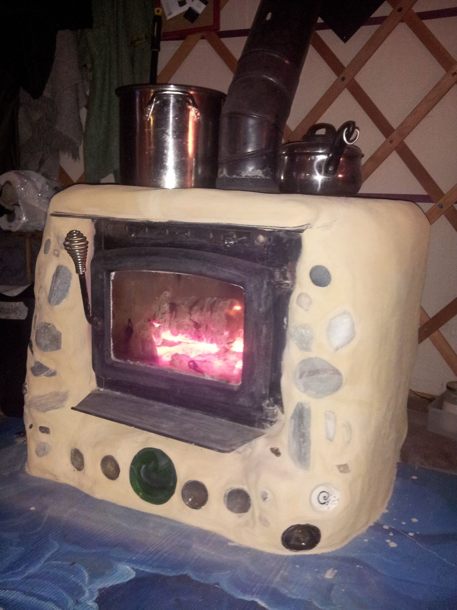 cobbing the stove, making the yurt even more cozy
