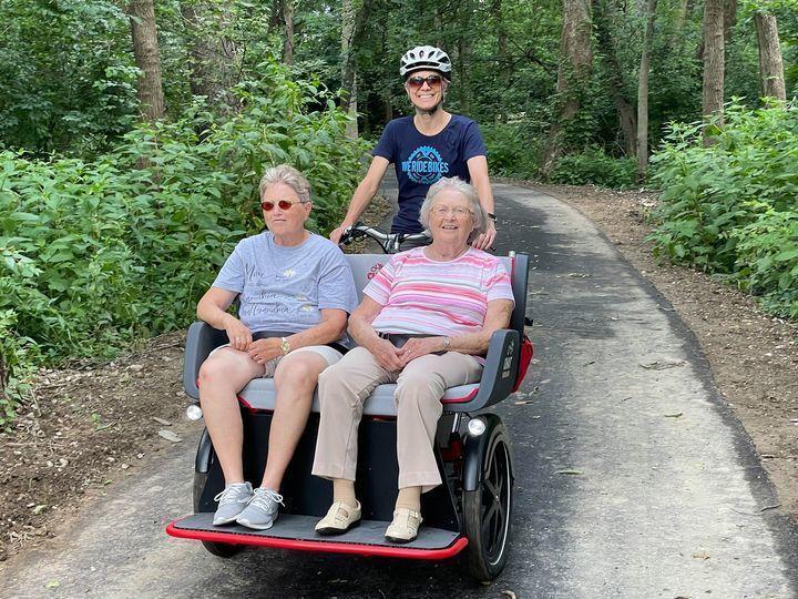 Cecelia takes two seniors for a ride on the trishaw