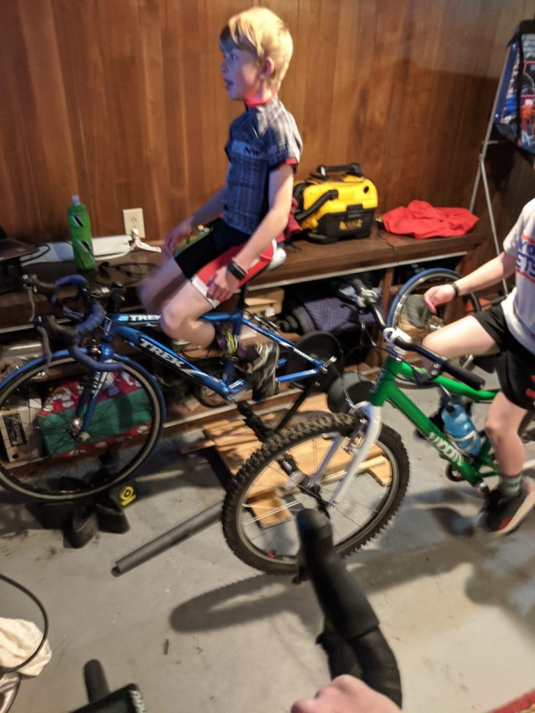 junior bike racer enjoying indoor ride