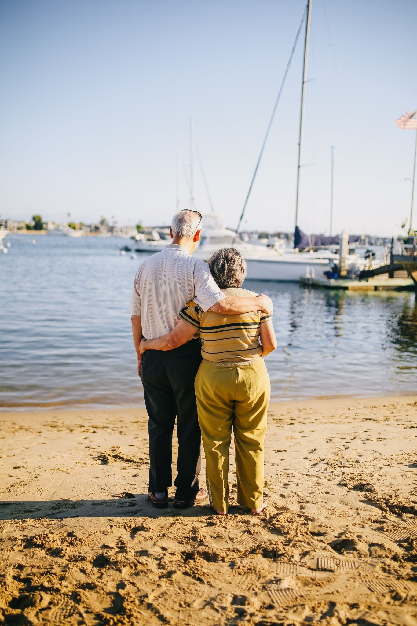 senior man and woman hugging with back to camera