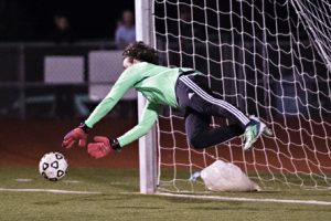 WATERTOWN, CT- 5 October 2015-100515EC11- Pomperaug's Tyler Flores successfully guards the goal iduring a penalty kick in Watertown Monday night. Erin Covey Republican-American