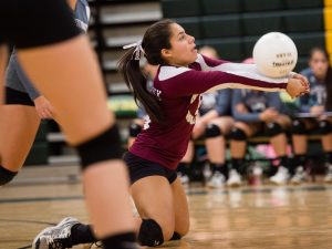 WATERBURY, CT - 8 October 2015-100815EC10-- Naugatuck's Jenna Massicotte dives for the ball against Holy Cross. The Greyhounds won, 3-0, at Holy Cross Thursday night. Erin Covey Republican-American.