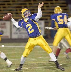 Seymour's Rob Moir tosses a touchdown pass during the Wildcats' 44-34 win over Tolland to capture the 2007 Class SS state championship at Trumbull High. (Jim Shannon/RA)