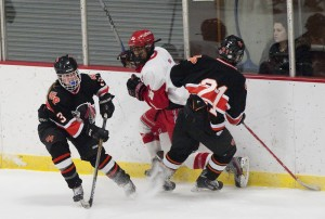 Watertown-Pomperaug's Mackenzie Bokina (3) plays the puck while teammate John Biello (21) and Cheshire's Sanjay Montagna battle on the boards during their game this season at Wesleyan's Spurrier-Snyder Rink in Middletown. (Jim Shannon Republican-American)
