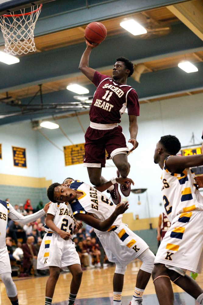Raheem Solomon takes the ball to the hoop hard against Kennedy Tuesday night. The Hearts won, 95-71. (Chris Massa/RA)