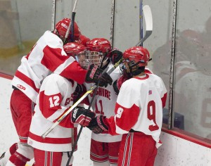 Cheshire's Billy McKinley (11) is congratulated by teammates after scoring a goal in their game against Watertown-Pomperaug Wednesday at the Spurrier-Snyder Rink on the Wesleyan University campus in Middletown. Jim Shannon Republican-American