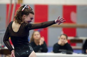 Pomperaug's Megan Muller competes in the floor exercise wduring their meet Tuesday at Pomperaug High School in Southbury.   Jim Shannon Republican-American