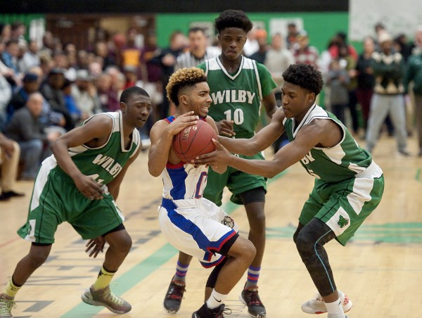 Crosby's Jordan Booker (00) gets caught in a trap by Wilby's Ezra Goodman (41), Ty'Quay Harding (10) and Damian Grant (25) in overtime of their NVL Semifinal game Monday at Wilby High School in Waterbury.  Jim Shannon Republican-American