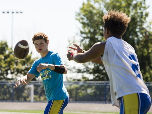 Seymour's Jaylen Kelley pitches the ball to Bobby Melms during practice. The WIldcats are ranked 14th in the preseason media poll. (Erin Covey/RA)