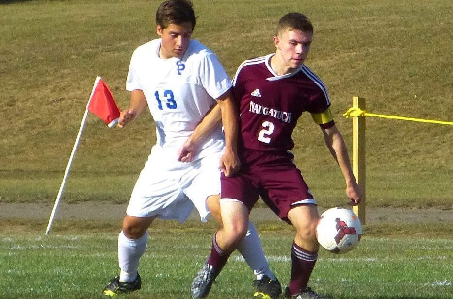 St Paul's Nathan Rinheart and Naugy's Devon Curtis battle for a loose ball during an NVL boys soccer game Friday in Bristol. The Greyhounds won it, 1-0. (Palladino/RA)
