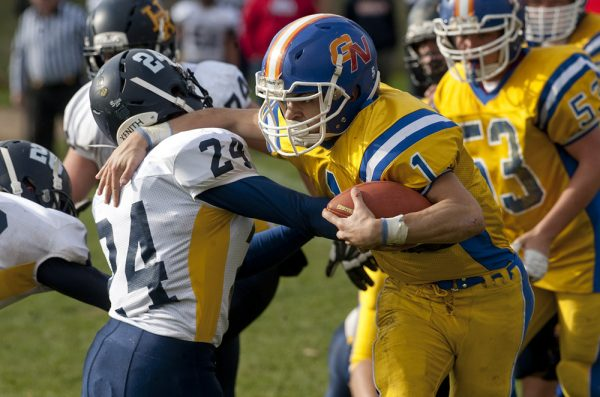 Gilbert-Northwestern's Billy Komons (1) sheds a tackle by Haddam-Killingworth's Jarrett Lemon  (24) during their game in Winsted. (Jim Shannon/RA)