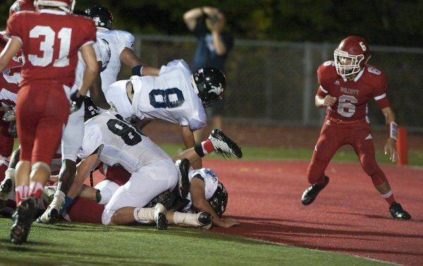Ansonia's Justin Lopez  (8) dives in for a touchdown during their game against Wolcott. (Jim Shannon/RA)
