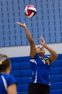 Seymour's Faith Thurmond helps the ball over the net Monday night in Oxford. Erin Covey Republican-American