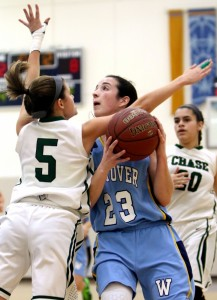 Gabbie Dunn of Westover School drives to the hoop as Morgan Maisto of Chase Collegiate School defends during basketball action in Middlebury. (Steven Valenti Republican-American)