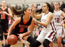 Watertown's Jordyn Forte (5) drives to the basket on Torrington's Kayla Williams (34) during their NVL game Tuesday at Torrington High School. Jim Shannon Republican-American