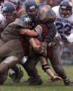 #21Mike Merrithew from Naugatuck High School is tackled hard from #76 Wilber Howard and #64 Ryan Wood both from Ansonia High School. PHOTO BY CRAIG AMBROSIO