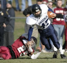 Ansonia #45, Brenton Dempsey breaks the tackle of Naugatuck High #25, Terrell Joyner during the Naugatuck-Ansonia Thanksgiving Day football game at Naugatuck High School Thursday morning. For Sports. JAMISON C. BAZINET PHOTO