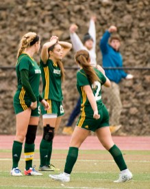 Holy Cross' Kiley Harnish (9) Madison Bushka (13) and (2) McKenna Ellsworth react after Old Lyme scored what would be the game-winning goal in overtime during their Class S state final game Saturday at Middletown High School. Jim Shannon Republican-American