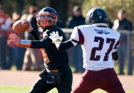 WATERTOWN, CT-112317JS06- Watertown's Nick D'Elia (4) gets the pass of despite pressure from a Torrington defender during their Thanksgiving Day game Thursday at Watertown High School. Jim Shannon Republican-American