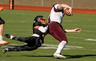 WATERTOWN, CT-112317JS14- Torrington's Ora Curry (11) gets dragged down by Watertown's Richard Ojeda (1) during their Thanksgiving Day game Thursday at Watertown High School. Jim Shannon Republican-American