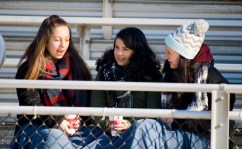 WATERTOWN, CT-112317JS16- Students Sarah Fox, left, and Rylee Reese, right, along with Emily Testone, a student from Woodland Regional High School in Beacon Falls, chat during half-time of the Watertown-Torrington Thanksgiving Day game Thursday at Watertown High School. Jim Shannon Republican-American