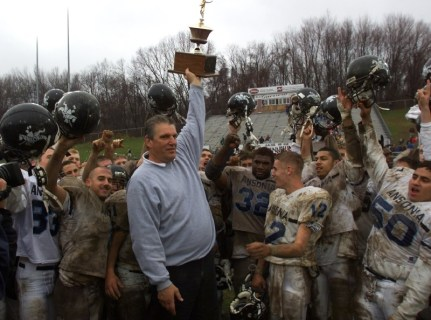 Head Coach Jack Hunt the Head Coach from Ansonia High School holds the winning trophy after defeating Naugatuck High School. PHOTO BY CRAIG AMBROSIO