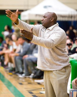 Kaynor Tech head coach Hank Spellman calls out instructions to his team during their game against Holy Cross in the city boys basketball jamboree Saturday at Wilby High School in Waterbury. Jim Shannon Republican-American