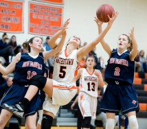 Watertown's Jordyn Forte (5) reaches for a rebound between New Fairfield's Allison Teklits (10) and Danielle Hernandez (2) during their non-league game Thursday at Watertown High School. Jim Shannon Republican-American