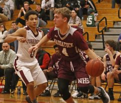 Naugatuck's Jesse Lanci (4) drives against Torrington's Dontae Thomas (0) during NVL basketball action Tuesday night at Torrington High School. Naugatuck defeated Torrington 49-46. Michael Kabelka / Republican-American