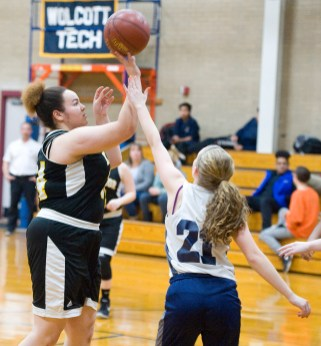 Kaynor Tech's Brianna Isaacs (34) puts up a shot over Wolcott Tech's Katie Benedict (21) during their game Thursday at Wolcott Tech school in Torrington. Jim Shannon Republican-American