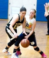 Kaynor Tech's Maggie DeSantis (13) and Wolcott Tech's Katie Benedict (21) scramble for a loose ball during their game Thursday at Wolcott Tech school in Torrington. Jim Shannon Republican-American