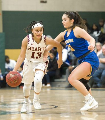 Sacred Heart's Mikayla Mobley (13) pushes the ball up court past Seymour's Sydnie Drezek (11) during their NVL girls basketball tournament game Saturday at Holy Cross High School. Jim Shannon Republican-American