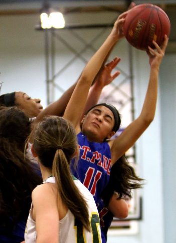 2017 NVL girls final: #11 Janessa Gonzalez of St. Paul High pulls down a rebound against Holy Cross High during 1st quarter action of the NVL Basketball championship at Kennedy High in Waterbury Wednesday. Steven Valenti Republican-American