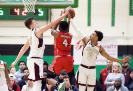 Sacred Heart's Connor Tierney (0) gets called for a foul while he and teammate Isiah Gaiter (4) go up to block a shot by Wilbur Cross' Jaykeen Foreman (4) during their Division I quarterfinal game Monday at Wilby High School in Waterbury. Jim Shannon Republican-American