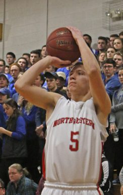 Northwestern Regional's Chris Nanni ( 5 ) puts up a shot up during the Division IV state tournament quarterfinals Monday night at Northwestern Regional High School. Northwestern defeated Lewis Mills 58 -35 Michael Kabelka / Republican-American
