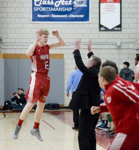 Wamogo's Garrett Sattazahn (12) celebrates with his father, assistant coach Jeremiah Sattazahn, after a time out was called during their win over East Hampton in the Division V semifinal game Wednesday at Wolcott High School. Jim Shannon Republican-American