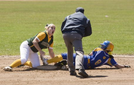 WATERBURY, CT-042118JS08- Holy Cross' Valerie Nobrega (25) reacts to a call after Seymour's Beca Findley (8) is called safe at second during their game Saturday at Holy Cross High School. Jim Shannon Republican American