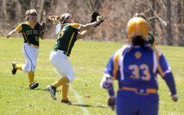 WATERBURY, CT-042118JS15- Valerie Nobrega (25) makes a running catch, in foul territory, during their game against Seymour Saturday at Holy Cross High School. Jim Shannon Republican American