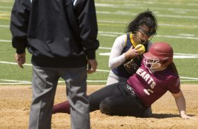 WATERBURY, CT-042818JS19- Sacred Heart's Taylor Benjamin (2) is tagged out at second base by Kennedy's Denise Rivera (2) while trying to stretch out a double during their game Saturday at Kennedy High School. Jim Shannon Republican American