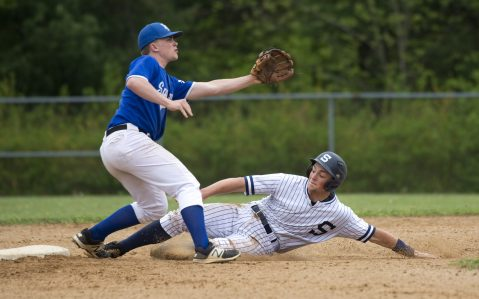 Shepaug's Ethan Hibbard (3) safely steals second base while Lewis Mills' Sam Buchanan (9) awaits the throw during their game Wednesday at Lewis Mills High School in Burlington. Jim Shannon Republican American