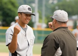 Colton's Kenny Kim (24), who came in for relief, is congratulated after closing out their win over Ontario during their Mickey Mantle World Series game Saturday at Municipal Stadium in Waterbury. Jim Shannon Republican-American