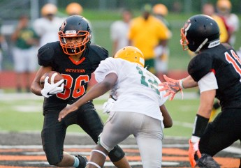 Watertown's Malik Minnifield (86) tries to avoid a tackle after catching a pass during their pre-season scrimmage against New London Friday at Watertown High School. Jim Shannon Republican American