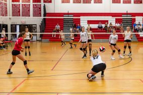 Izzy Brainerd of Pomperaug hits a ball back over the net as Pomperaug hosts Seymour in a girls volleyball scrimmage at Pomperaug High School in Southbury on Monday afternoon. Bill Shettle Republican-American