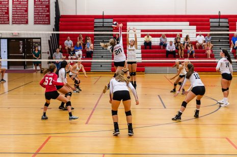 Iggy Genovese #20 of Pomperaug spikes the ball at the net as Pomperaug hosts Seymour in a girls volleyball scrimmage at Pomperaug High School in Southbury on Monday afternoon. Bill Shettle Republican-American