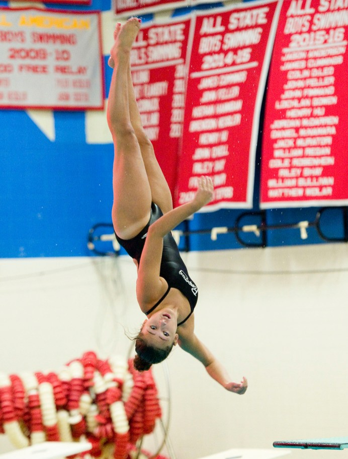 Pomperaug's Julia Markward performs her dive during their meet against Stratford in SWC swim action Tuesday at Pomperaug High School. Jim Shannon Republican American