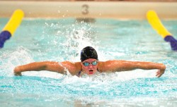Seymour's Sierra Cripps competes in the 100M butterfly during their meet with Sacred Heart Wednesday at Kennedy High School in Waterbury. Jim Shannon Republican American