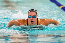 Sacred Heart's Trista Caron competes in the 100M butterfly during their meet with Seymour Wednesday at Kennedy High School in Waterbury. Jim Shannon Republican American