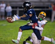 Ansonia's Jalen Johnson (10) can't hold on to a reception while being brought down by Holy Cross' Qaron Brown (2) during their game Friday at Nolan Field in Ansonia. Jim Shannon Republican American